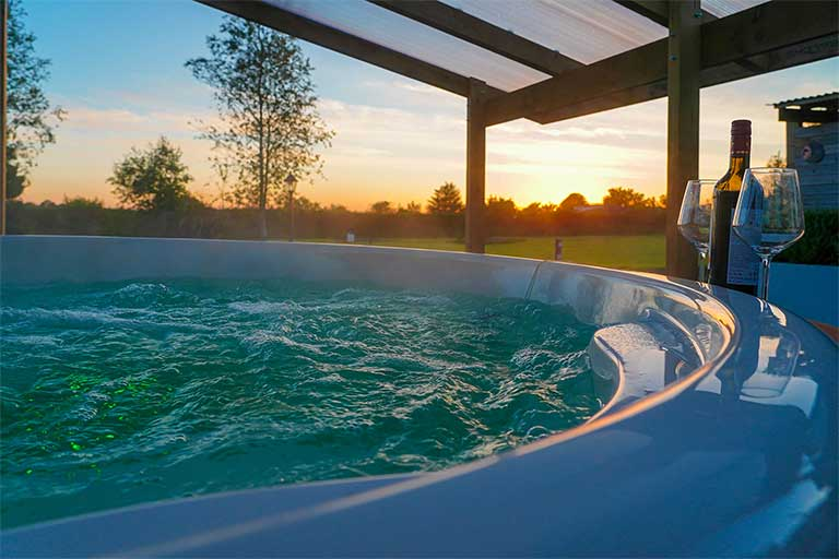Yurty ahern exterior hot tub with bubbles